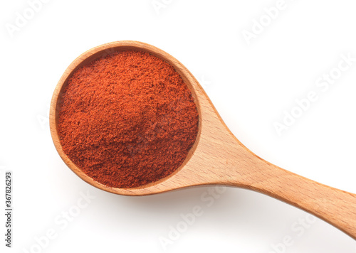 Foto Top view of of red paprika powder in wooden spoon