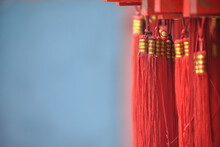 Red Fringes Under Bars With Wishes. Taishan Mountain Temple.