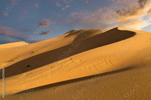 Sand dunes known as Singing Dunes in Kazakhstan Canvas Print