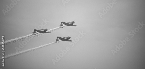 airplane acrobacy on the sky vintage planes Wallpaper Mural