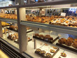 KUALA LUMPUR, MALAYSIA -JULY 17, 2020: Various types of breads are displayed for sale inside the bakery display rack. Made in various designs to provide variations to customers.
