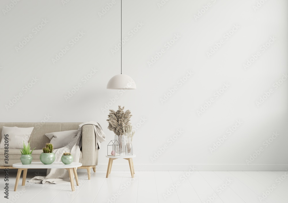 Fototapeta Empty living room with brown color sofa/ornamental glass jar and table on empty white wall background.