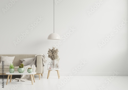 Fotografering Empty living room with brown color sofa/ornamental glass jar and table on empty white wall background