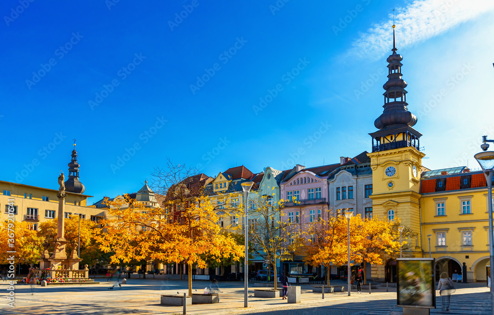 Fototapeta View of Masaryk Square, central square of Ostrava city overlooking Old Town Hall and Marian column on sunny autumn day, Czech Republic