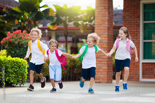 Child going back to school. Start of new school year after summer vacation. Little girl with backpack and books on first school day. Beginning of class. Education for kindergarten and preschool kids. - 367943475