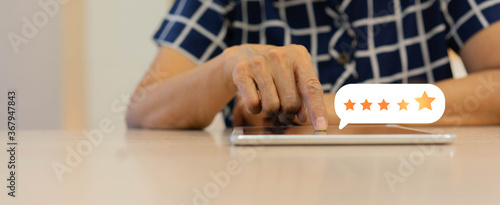 Valokuva close up on customer senior woman hand pressing on smartphone screen with gold f