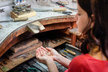 Female Jeweler With Silver Acc...