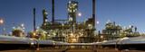 Fototapeta Do pokoju - Pipelines leading to an oil refinery