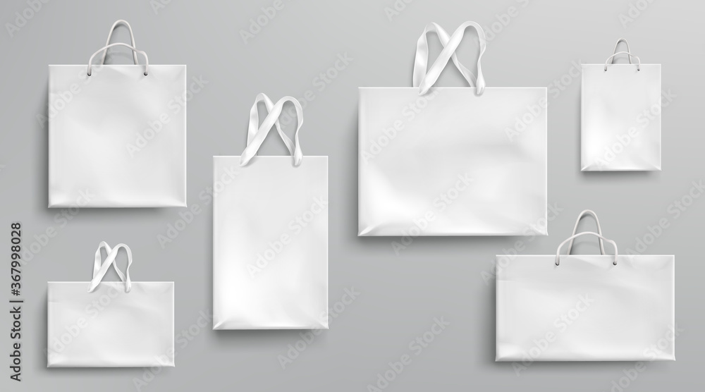 Fototapeta Paper shopping bags mockup, white packages with rope and lace handles, blank rectangular ecological gift packs, isolated mock up for branding and corporate identity design, Realistic 3d vector set