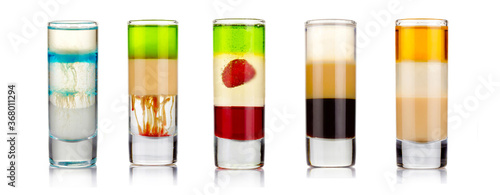 Set of sliced shot cocktails isolated on white