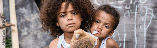 panoramic orientation of poor african american kids looking at camera Canvas Print