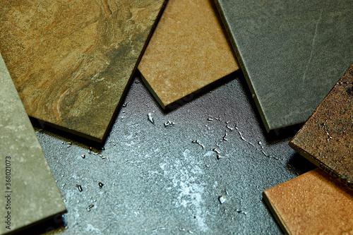 Fotografie, Obraz Frame of various different decorative tiles samples on stone background