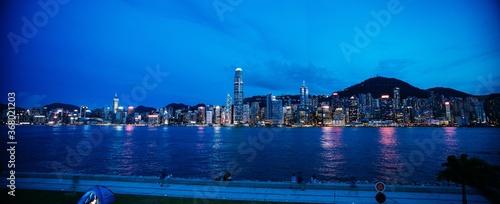 Obraz Panoramic shot of a cityscape at night - fototapety do salonu