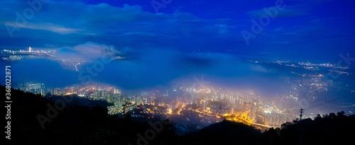 Obraz Panoramic shot of cityscape at night - fototapety do salonu