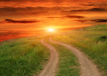 Dirt Road On Sunset Background