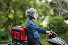 The Staff Prepares The Delivery Box On The Motorcycle For Delivery To Customers.