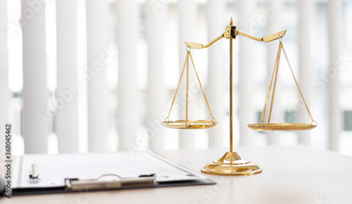 Obraz Background images, Hammer referees and Legal documents of justice, Legal scales and legal accuracy concept. - fototapety do salonu