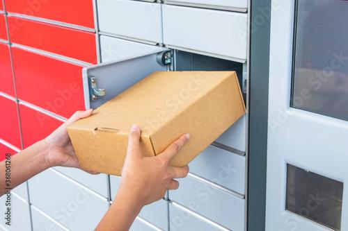 Fotografia, Obraz Post terminal machine and parcel delivery