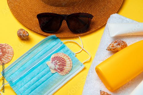 Obraz Sunscreen cream and protective mask. Coronavirus summer concept - fototapety do salonu