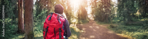 Fotografie, Obraz Young woman hiking and going camping in nature