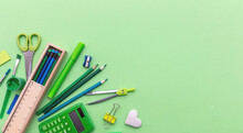 School Supplies On Green Color...