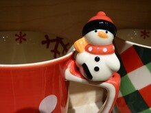 Closeup Shot Of A Snowman On A Ceramic Christmas Cup