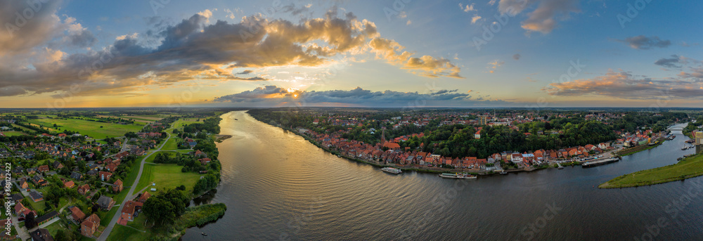 Fototapeta Panoramic aerial view  of the River Elbe and historic shipping town Lauenburg and its surrounding area in district of the duchy Lauenburg, Schleswig-Holstein, Germany