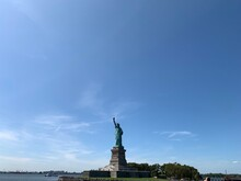 The Statue Of Liberty Under Clear Blue Sky