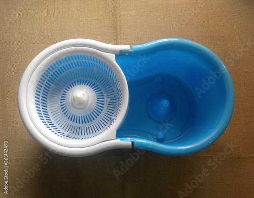 Fototapeta White and blue color plastic spin mop bucket obraz na płótnie