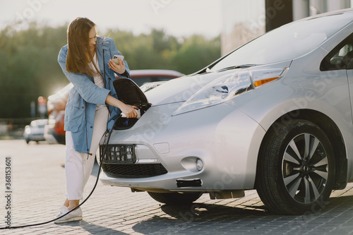 фотография Charging electro car at the electric gas station