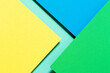 canvas print picture - Abstract color papers geometry flat lay composition background with blue, yellow and green color tones