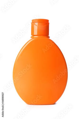 Bottle of sunscreen on white background