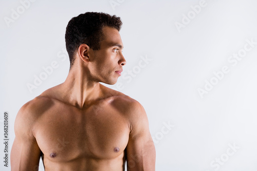 Obraz Close-up portrait of his he nice attractive content serious sportive tanned guy looking aside working out steroid protein effective result isolated over light white pastel color background - fototapety do salonu