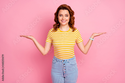 Portrait of her she nice-looking attractive lovely pretty cheerful cheery wavy-haired girl holding on two palms advice recommend isolated over pink pastel color background