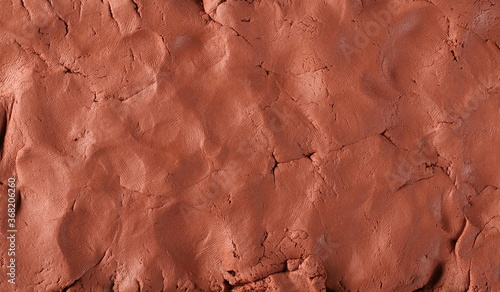 Red modelling clay, playdough surface, texture and background Fototapeta