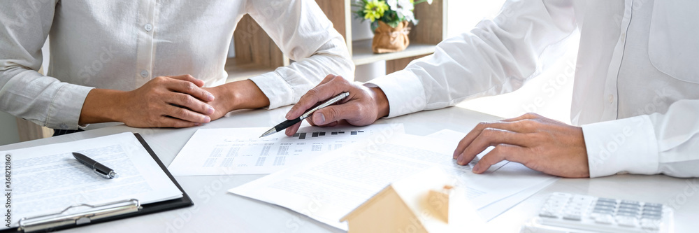 Fototapeta Estate broker agent presenting and consult to customer decision making sign insurance form agreement