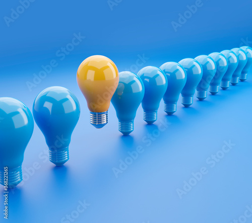Obraz Outstanding glowing yellow light bulb among blue light bulbs 3D illustration with clipping path. 3D rendering - fototapety do salonu