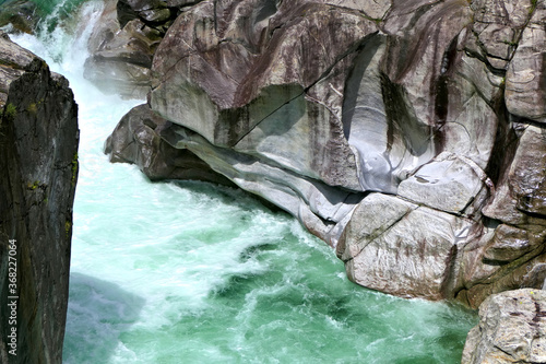 Closeup of the green Verzasca River and abraded rocks in Valle Verzasca valley i Wallpaper Mural