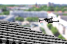 Drone In The Air Inspecting The Roof Over The House. Close-up