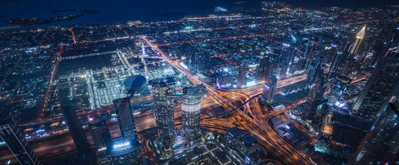 Fototapeta na wymiar Commercial Building At Night In United Arab Emirates