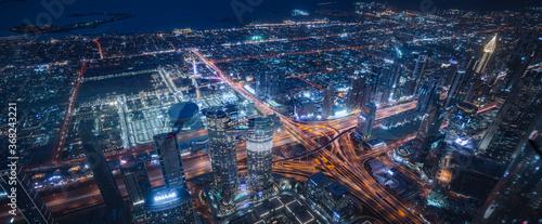 Obraz Commercial Building At Night In United Arab Emirates - fototapety do salonu