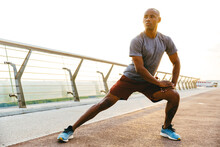 Relaxed African Sportsman Stretching Exercise