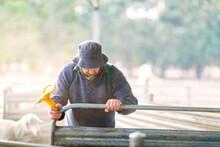 Farmer With Floppy Hat Shuttin...