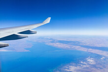 Aeroplane Wing And View Over Coastal Land In SA