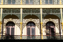 Shadows From Wrought Iron Arches Cast Onto The Facade Of An Historic Building
