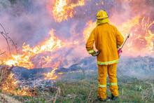 A Fireman Using A Torch Watchi...