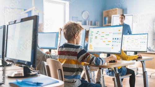 Elementary School Computer Science Classroom: Smart Little Schoolchildren Work on Personal Computers, Learn Programming Language for Software Coding Wallpaper Mural