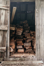 Firewood Stacked In The Shed.