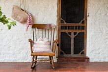 Rocking Chair On A Verandah.