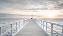 Long White Pier At Sunrise
